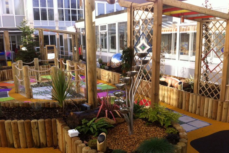 A sensory garden with water features and shaped log planters