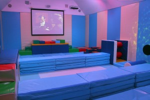 Soft play room with folding floor padding to use as cinema