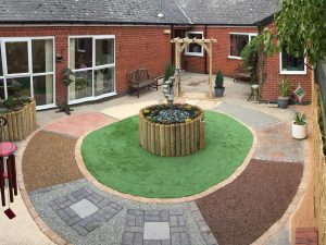 Dementia Garden Mosaic Pathway with Water Feature in Courtyard