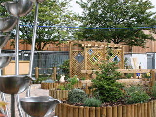 Rainbow Pergola and Water feature in sensory garden